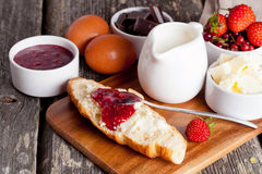 Croissant with strawberry jam and fresh berries. Close up, horizontal Royalty Free Stock Image