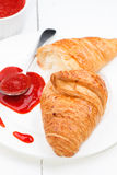 Croissant and strawberry jam and spoon Royalty Free Stock Photography
