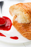 Croissant strawberry jam spoon close up Royalty Free Stock Photo