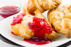Croissant with strawberry jam on white plate Stock Photo