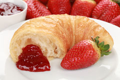 Croissant with strawberry marmalade Stock Photos