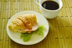 croissant stuffed pork bologna and green oak with black coffee Royalty Free Stock Image