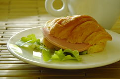 croissant stuffed pork bologna and green oak with coffee Royalty Free Stock Photography
