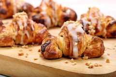 Croissant stuffed with walnuts on wooden background Royalty Free Stock Images