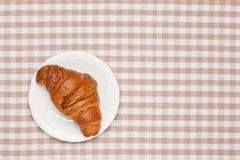 Croissant on the table cloth Royalty Free Stock Images