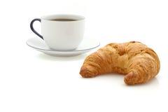 Croissant, taza de café Foto de archivo