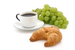 Croissant, taza de café Imagenes de archivo