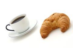 Croissant, taza de café Fotografía de archivo