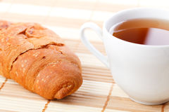 Croissant and tea Royalty Free Stock Photo