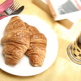 Croissant and tea Stock Images