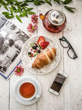 Croissant and tea Royalty Free Stock Photos