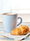 Croissant and tea cup Stock Photos