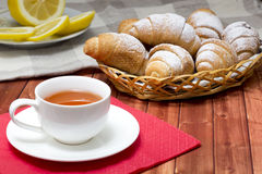 Croissant tea. Fresh croissant served to sweet tea Stock Images