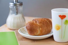 Croissant with tea. Croissant with tea and jam Royalty Free Stock Photography