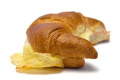 Croissant w/ Ham and Cheese (Side View). Croissant with ham and cheese against white background Stock Images