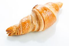 Croissant on white background. Top view. Royalty Free Stock Photo