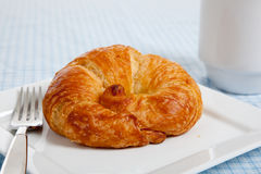 A croissant on a white plate Royalty Free Stock Photography
