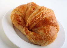 Croissant on white plate Stock Image