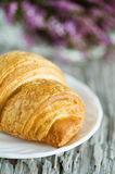 Croissant on the white plate Royalty Free Stock Photos