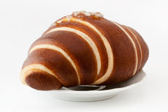 Croissant on white plate. Clipping paths. Stock Image