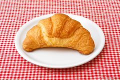 Croissant on white plate Royalty Free Stock Photo