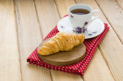 Croissant on wood table Royalty Free Stock Photo