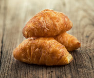 Croissant on wooden table Stock Photo