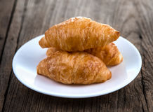 Croissant on wooden table Stock Image