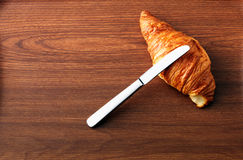 Croissant on wooden table Stock Images