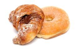 Croissant y buñuelo foto de archivo libre de regalías