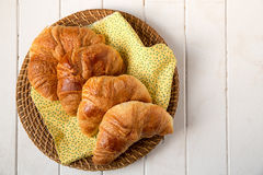 Croissant on yellow napkin Stock Images
