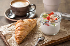 Croissant and yogurt Stock Images