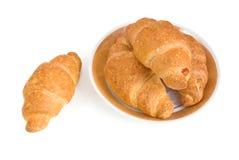 Croissanten op plaat Stock Foto