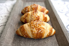 Croissants. Close up image of croissants on wooden plate Stock Image