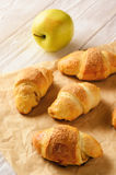 Croissants with apple jam on wooden background. Stock Images