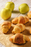 Croissants with apple jam on wooden background. Royalty Free Stock Photography