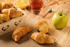 Croissants with apple jam on wooden background. Stock Image