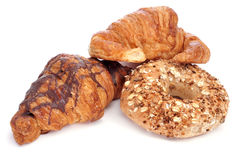 Croissants and bagels. Some croissants and a bagel on a white background Royalty Free Stock Photography