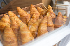 Croissants in bakery shop`s window display Royalty Free Stock Photography
