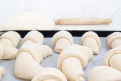 Croissants before baking together Stock Photography