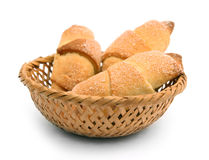 Croissants in a basket. Isolated on white Royalty Free Stock Photo