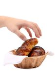Croissants in a basket with hand. Royalty Free Stock Photos