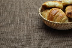 Croissants in a basket on the place mat Stock Photo