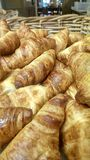 Croissants. In a basket ready for the breakfast buffet stock image