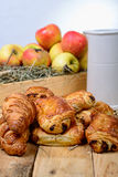 Croissants with a box of apples Royalty Free Stock Images