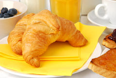 Croissants for breakfast. Served with coffee, orange juice and toasts stock photos