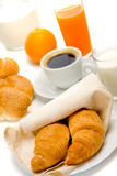 Croissants for breakfast. Croissants with coffe, milk and orange juice served for breakfast Royalty Free Stock Photo