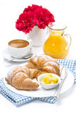 Croissants with butter, coffee and orange juice for breakfast Royalty Free Stock Images