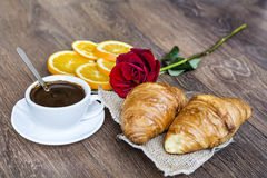 Croissants with butter ,cup of coffee and orange  for breakfast Royalty Free Stock Photo