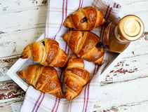 Croissants and caramel on the wooden tray Stock Images